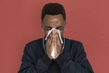 Young african man posing in studio