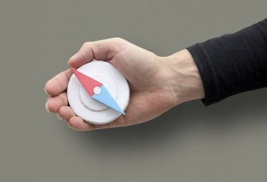 Human Hand Holding Compass