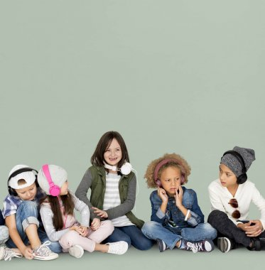 multicultural group of children listening music