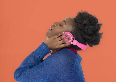 African woman in headphones