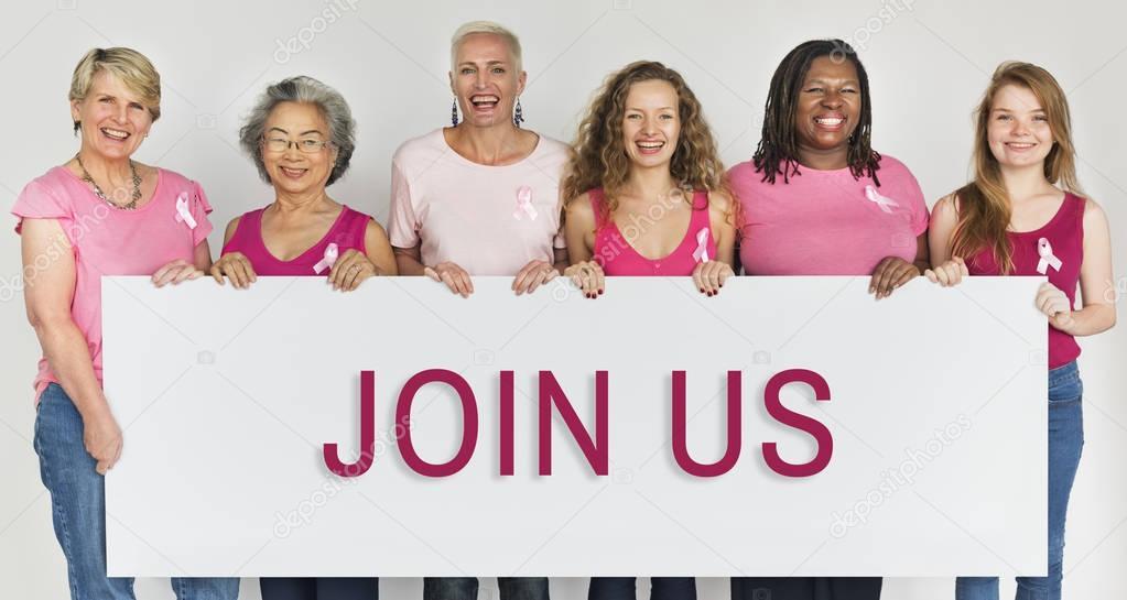 Diversity women holding informational board