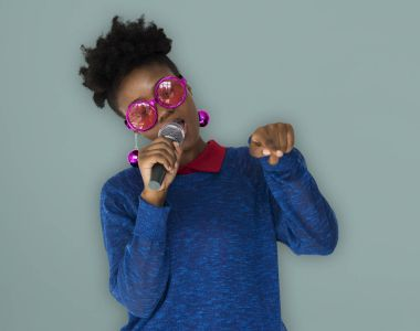 african woman in glasses singing