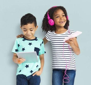 Multiethnic children using digital devices