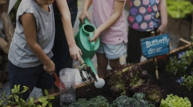 kids learning gardening outdoors