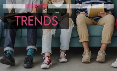 stylish friends using digital devices