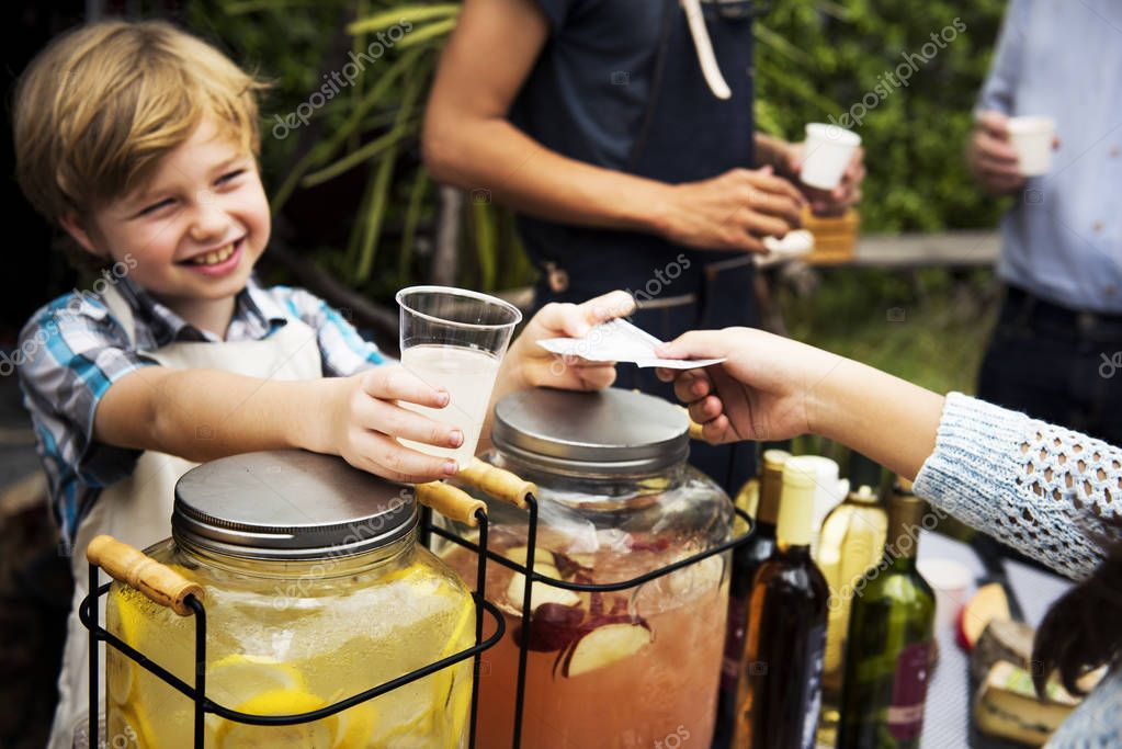 boy selling lemonade