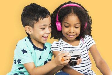 Children in studio using headphones and camera