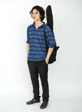 Musician guy carrying guitar