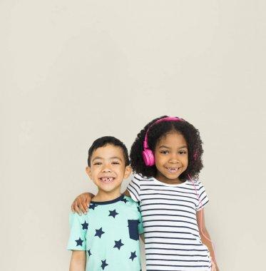 Multiethnic children hugging