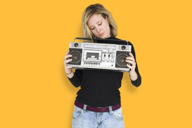 Woman holding media player boombox