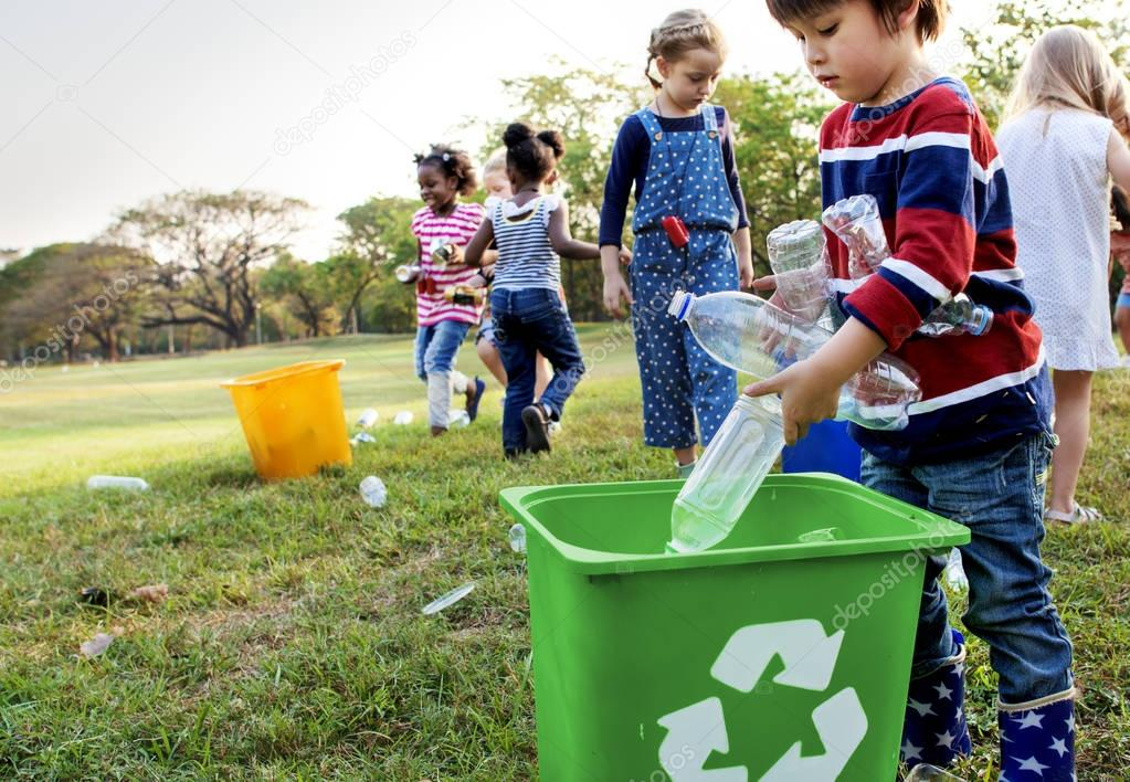 kindergarten kids cleaning garbage