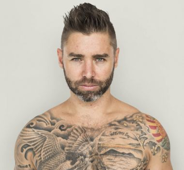 shirtless tattooed man