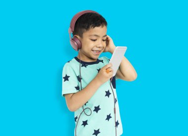 Boy holding using mobile