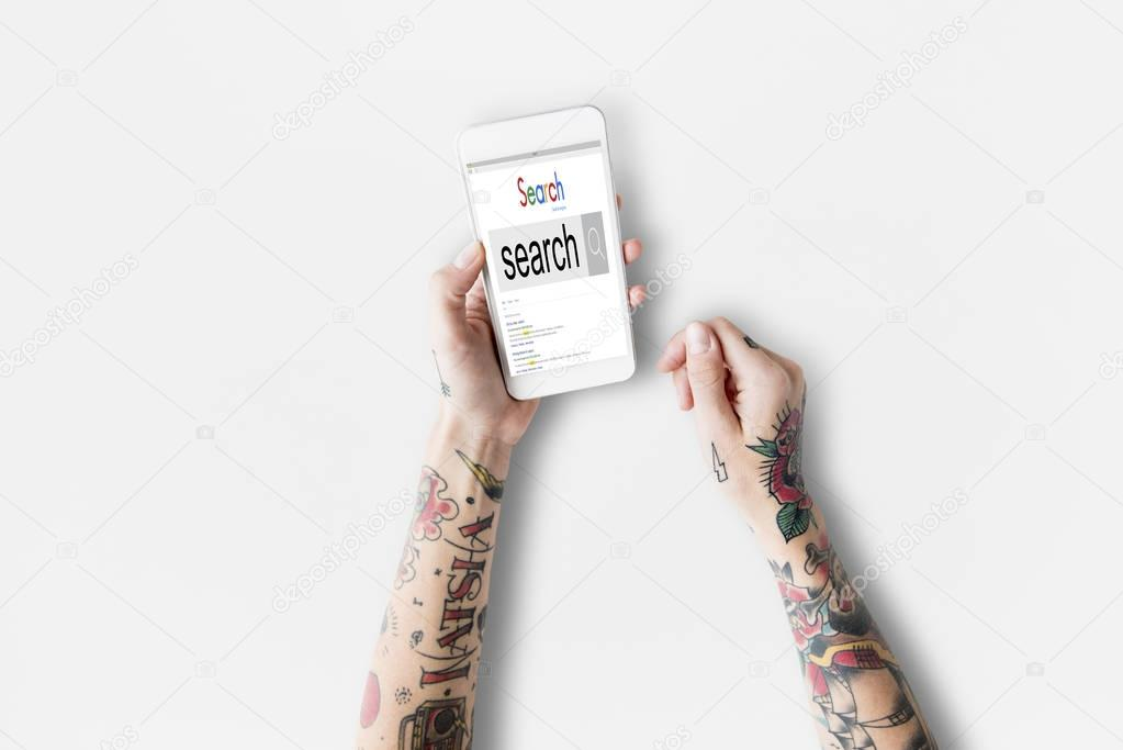 Tattooed woman hands with smartphone
