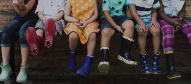 Group of kindergarten kids siting outdoors