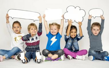 children holding speech bubbles