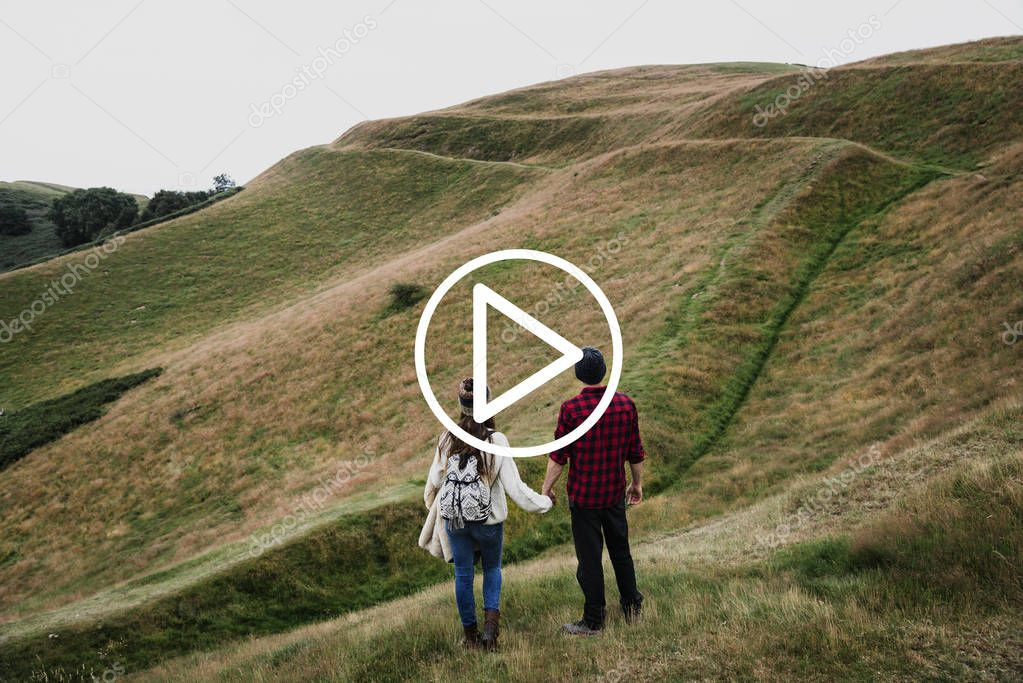 Couple standing in mountain hills