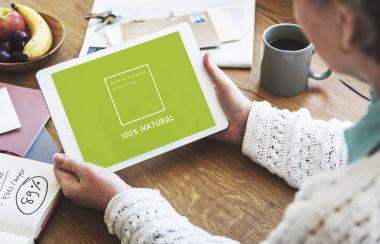 human hands holding digital tablet