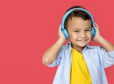 Boy Listening Music in blue headphones