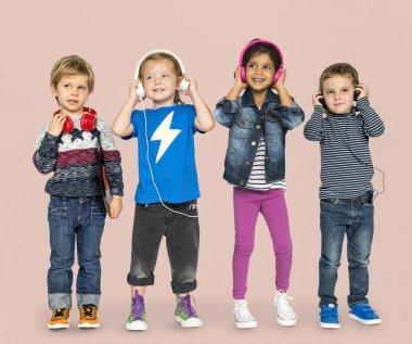 Cheerful children listen music