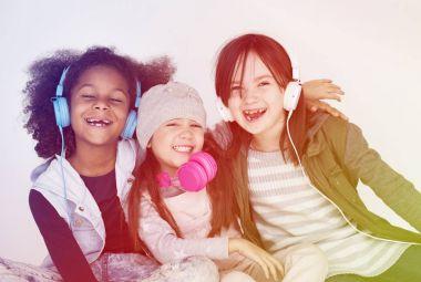 Little girls in headphones