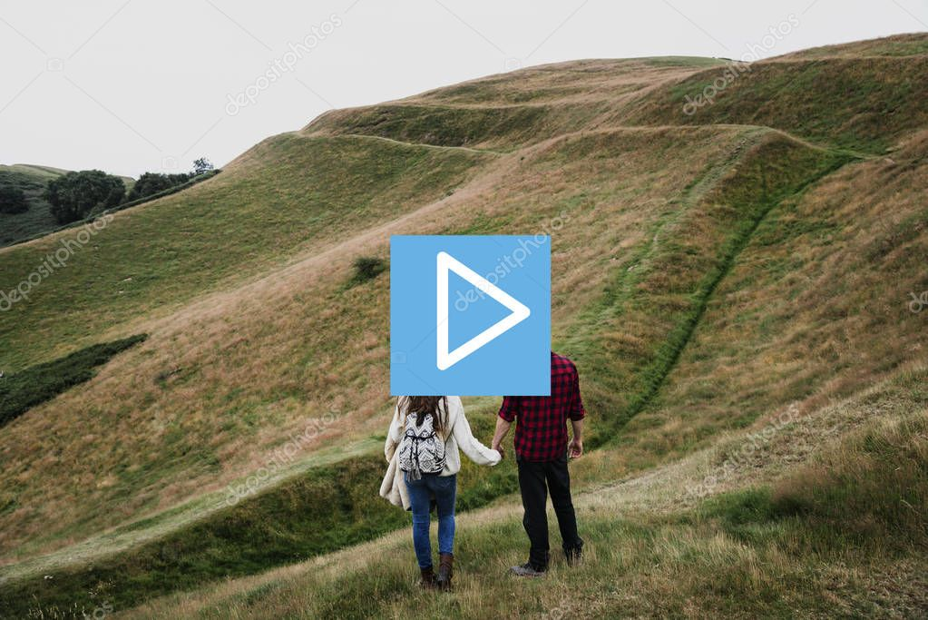 Couple standing on mountain hills