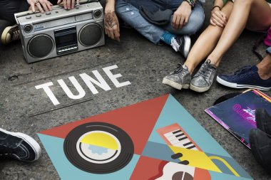 Teenagers sitting on floor with boombox