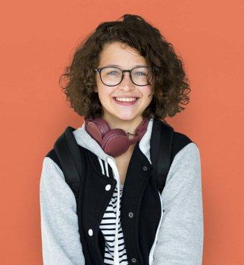 Smiling teenager girl with headphones
