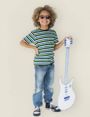 Little boy with paper guitar