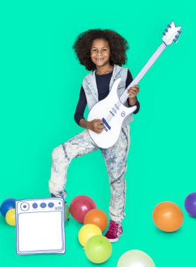 African american girl with paper guitar