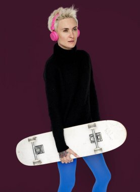 Woman in headphones with skateboard