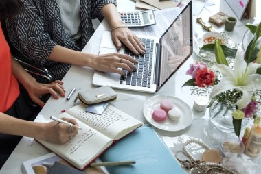 women using laptop with online shopping, promotion and purchase concept