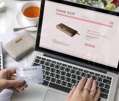 woman using laptop with online shopping, promotion and purchase concept