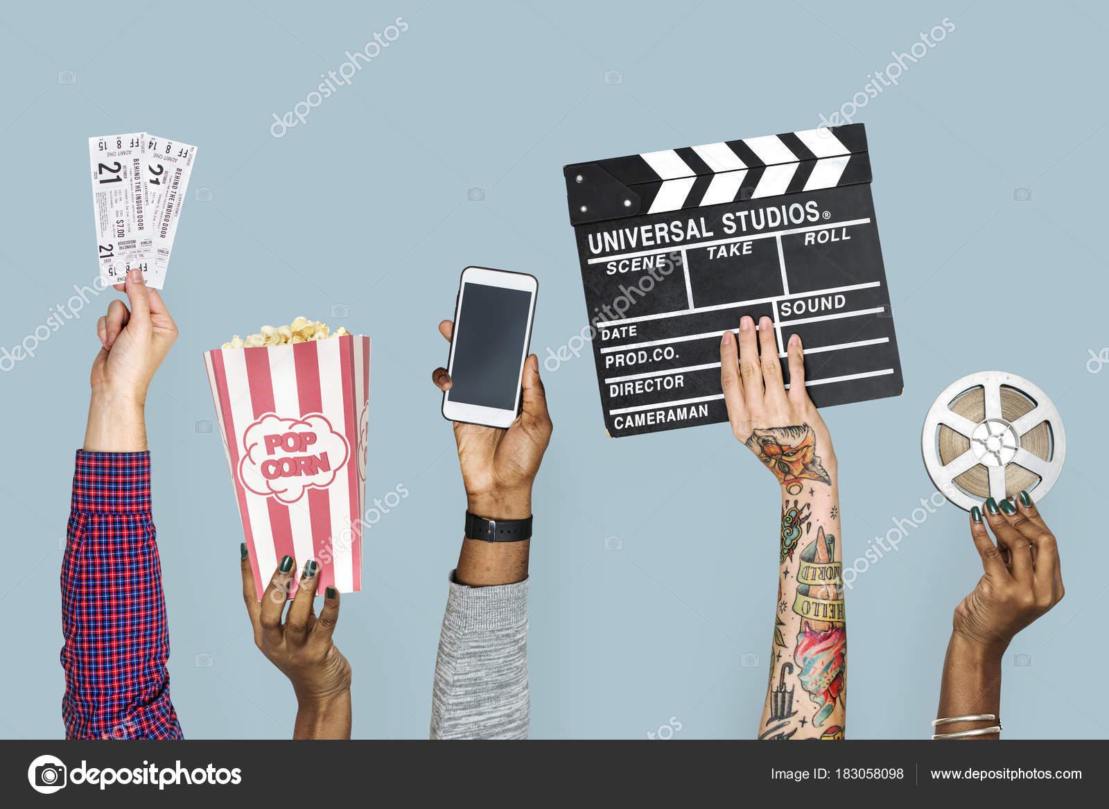 cropped image people hands holding cinema stuff fotografias de