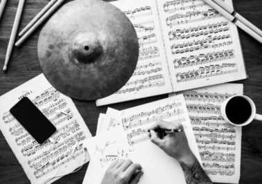 Top view on Man working with musical notes, black and white