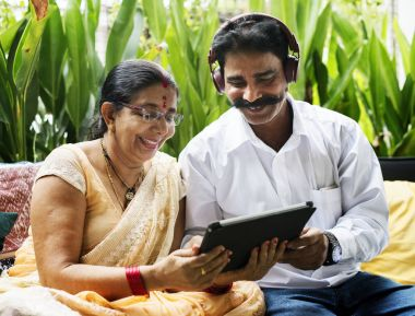 Elderly Indian couple using digital tablet