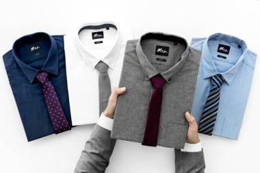 Businessman selecting shirt to wear