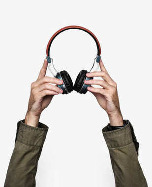 Hand holding variation of headphones