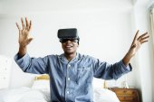 Fotografie A man experiencing VR in bed