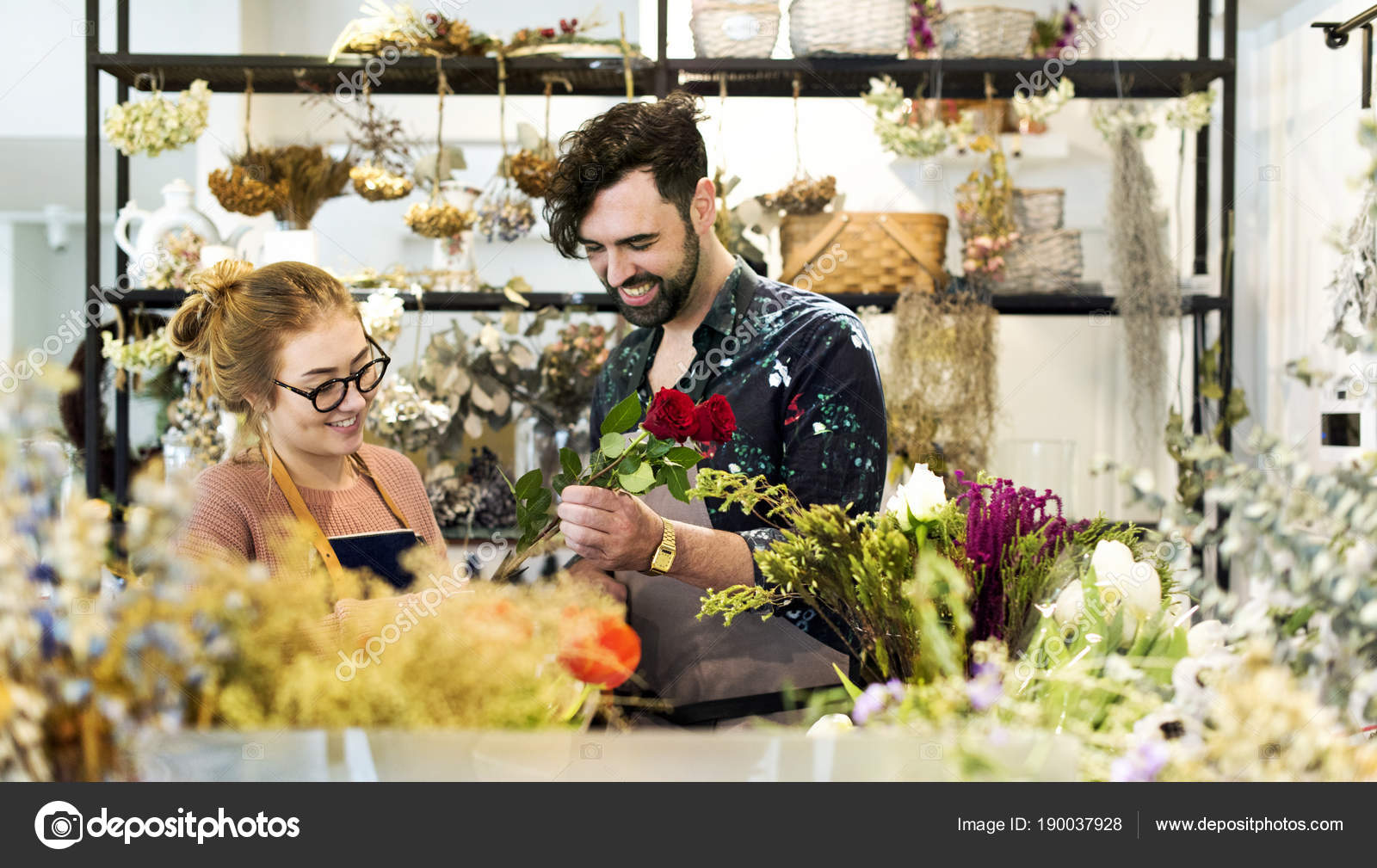Florists making flower bouquet together stock photo rawpixel florists making flower bouquet together stock photo izmirmasajfo
