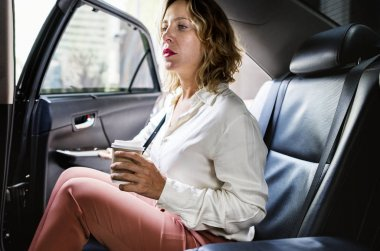 Woman sitting in a car