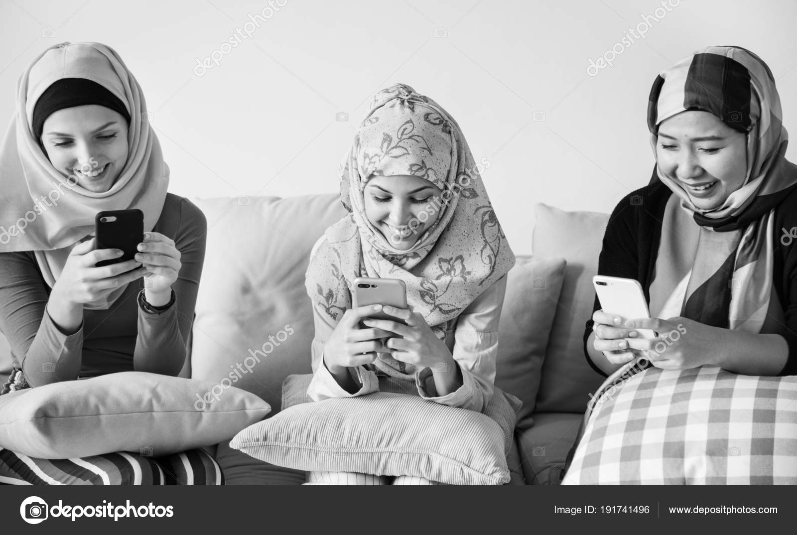 Awesome Group Islamic Women Sitting Couch Using Smart Phones Stock Gmtry Best Dining Table And Chair Ideas Images Gmtryco