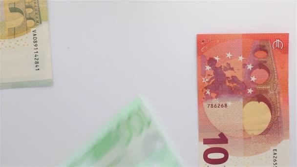 Euro banknotes drop down quickly