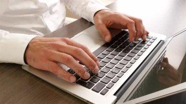 Business man typing keyboard on laptop