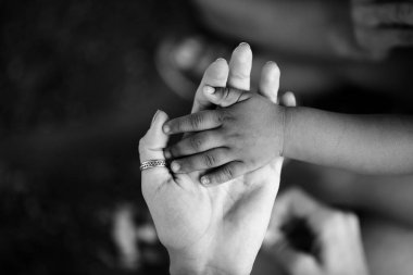 Hands of child and adult. Black and white hand. Trust and support, motherhood and childhood, parent and son or daughter. Children of Africa. Family and love between mother and child