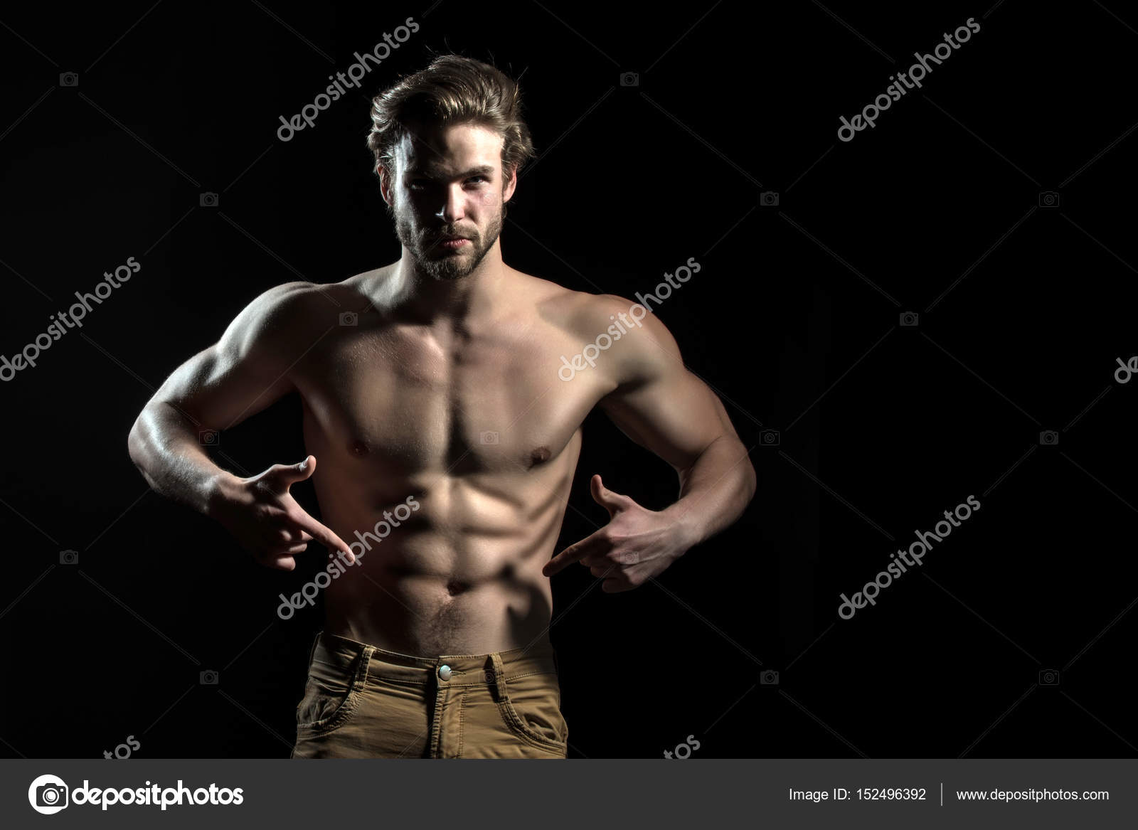 Man is pointing at his naked athletic belly. Muscles of young strong  bearded guy. Attractive sexy man — Photo by ...