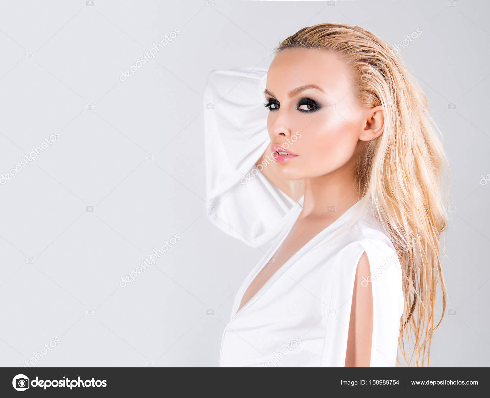 Woman In White Blouse On White Background With Beautiful Make Up