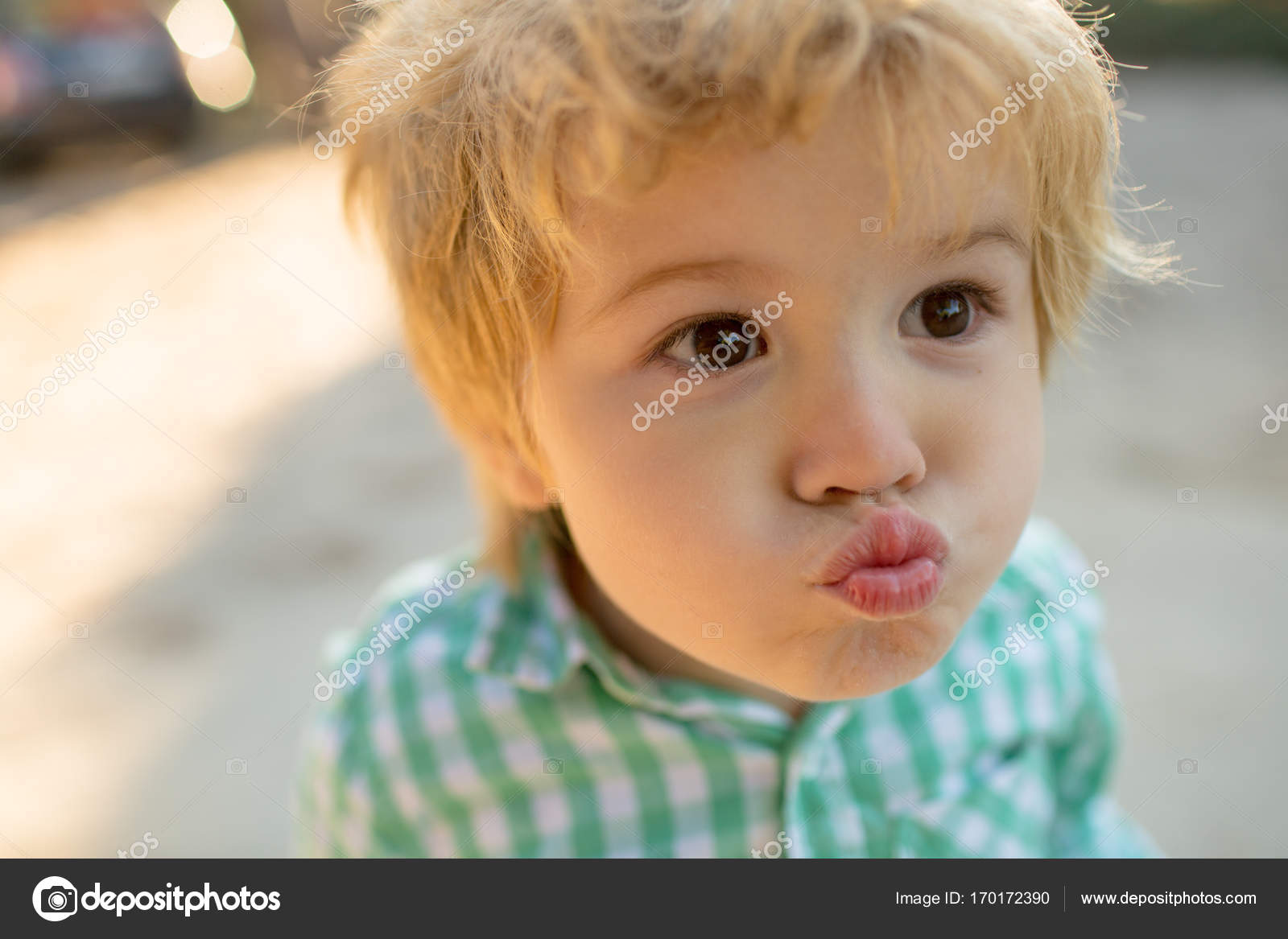 kiss, kissing boy. boy in love, funny face of cute kid close up