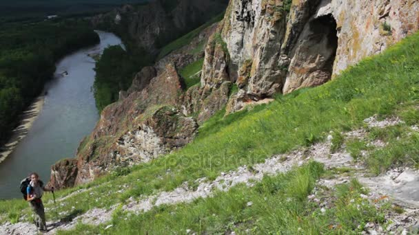 Hiker woman is walking mountain,