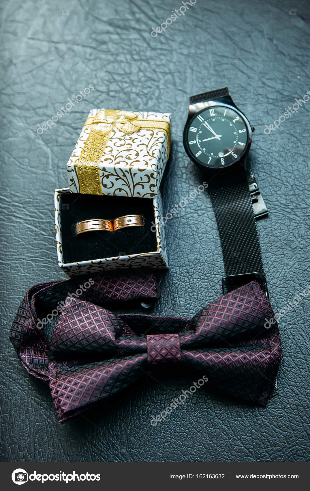 Mens accessories for groom at wedding watches bow tie and rings